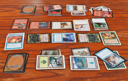 Photo pour MOSCOW, RUSSIA - MARCH 24, 2013: wizards battle in card game Magic: The Gathering. The game was created by Richard Garfield and first published in 1993 by Wizards of the Coast. - image libre de droit