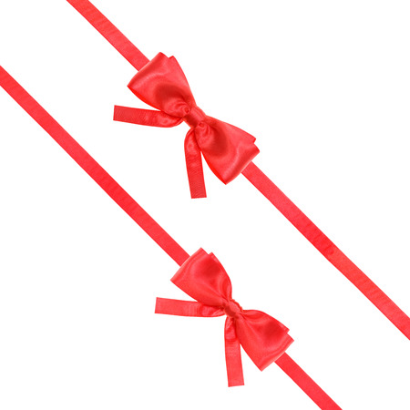 two red satin bows and two diagonal ribbons isolated on square white background