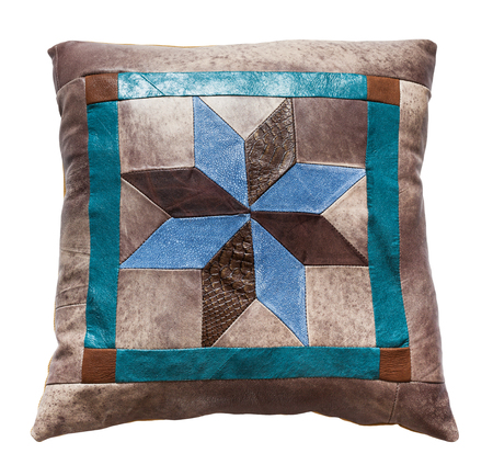 Photo pour top view of handmade leather decorative pillow with star pattern isolated on white background - image libre de droit