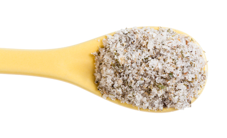 Photo pour top view of ceramic spoon with seasoned salt with spices and dried herbs close up isolated on white background - image libre de droit