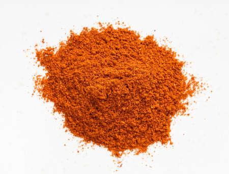Foto für top view of pile of chili powder from cayenne pepper close up on gray ceramic plate - Lizenzfreies Bild