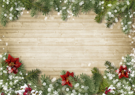 Christmas border with poinsettia on old wood background