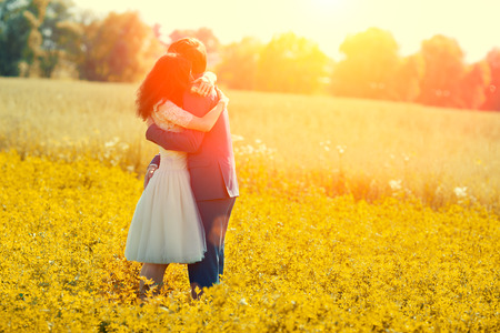 Jast married couple hugging in the meadow