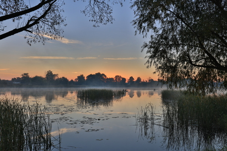 Foto per Early morning, sunrise over the lake. Rural landscape. - Immagine Royalty Free