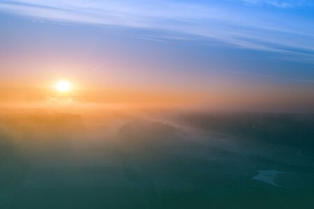 Photo pour Early misty morning. Sunrise in countryside. Rural landscape in early spring. Aerial view - image libre de droit