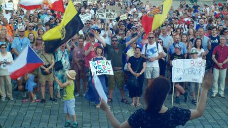 Demonstration of people crowd against the Prime Minister Andrej Babis and president Milos Zeman, a banner with a draw with Babis lied yesterday yesterday today, holding children, government and politics Prague in the Czech Republic. Europe, European Union