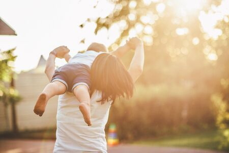 Photo for mom and child playing in the yard - Royalty Free Image