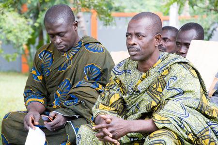 Anekro, Ivory Coast - 21 August 2015: gathering of the leadership under the palaver tree. Men under loincloths sat under the palaver tree, listening to Their partner Carefully