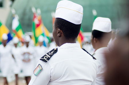 Abidjan, Ivory Coast - August 3, 2017: shoulder pad ceremony to students leaving the Maritime Academy. group of women sailors dressed in white standing during graduation