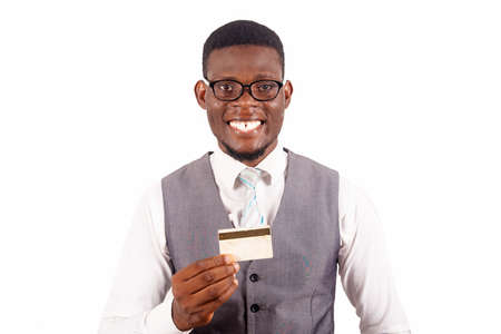 Photo pour Handsome business man holding credit card with a happy face standing and smiling with a confident smile showing teeth - image libre de droit