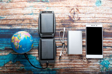 Global energy for devices. Devices and the globe. Top.