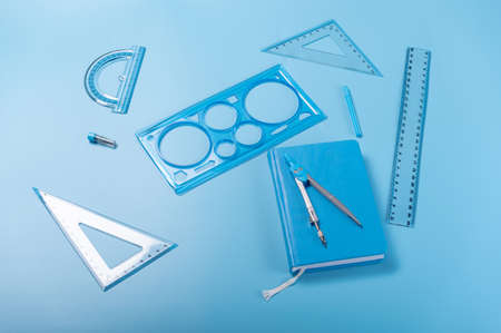 Photo pour Compasses and rulers. Compass and notepad. Compasses and rulers for sketching. Angle view. - image libre de droit