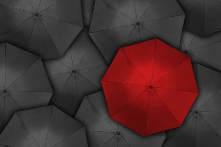 Photo pour Standing out from the crowd, high angle view of red umbrella over many dark ones - image libre de droit
