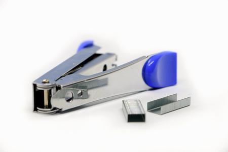 Stapler on the white background. Miscellaneous of office equipment. Paper clip,Stapler