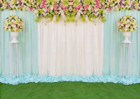 Beautiful backdrop flowers and fabric for wedding ceremony.