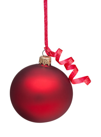 A red Christmas Ornament handing from a red curly ribbon. Isolated on a white background.