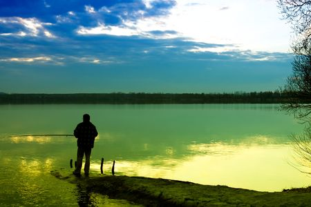 Photo pour Fishing in a lake  - image libre de droit