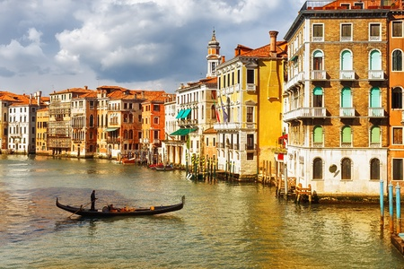 Venice homes and gondola in the canal