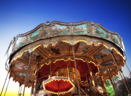 Vintage carousel at sunset in Paris
