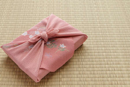 Photo for Japanese wrapping cloth 'Furoshiki'. 'Furoshiki' are square shaped cloths used in Japan to wrap items and carry them. - Royalty Free Image