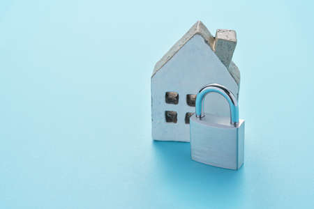 Photo for Padlock and miniature house on color background - Royalty Free Image