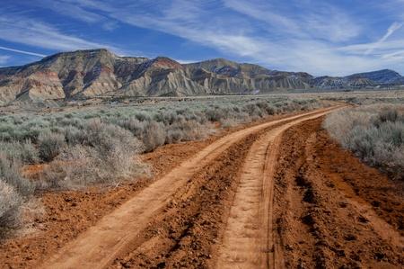 Foto de Desert Road:  A rough dirt road leads into the North Fruita Desert in western Colorado. - Imagen libre de derechos