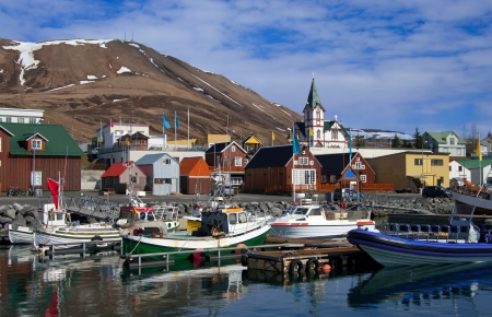 Icelandic Seaport: Boats for fishing and for whale watching tours gather at the port of Husavik, Iceland.