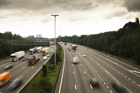 The highway ring around Antwerp in Belgium with cars and speed signals