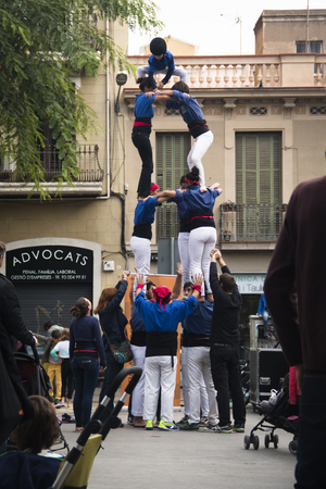 BARCELONA, SPAIN  CIRCA OCTOBER 2015: People making a human pyramid in Barcelona in Spain