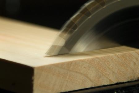 Circular Saw blade making a Cross Cut through a board