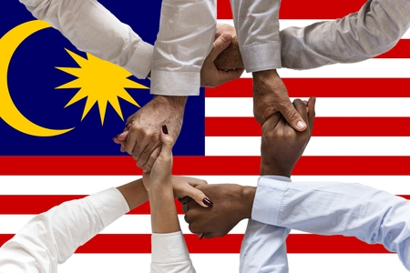 Photo pour Flag of Malaysia, intergration of a multicultural group of young people. - image libre de droit