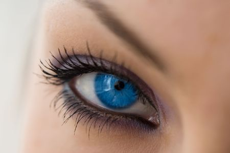 beautiful woman`s open blue eye