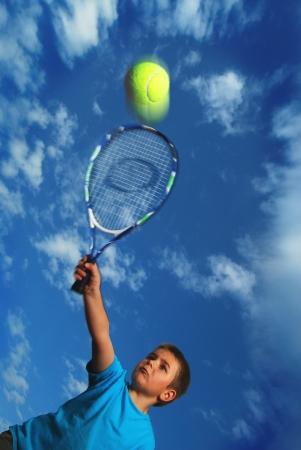 Tennis serve from little boy