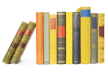 vintage books in a row, isolated on white background, blank labels ,free copy space