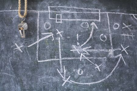 Photo pour Soccer tactics diagram scribble and whistle of soccer or football referee on a black board, copy space - image libre de droit