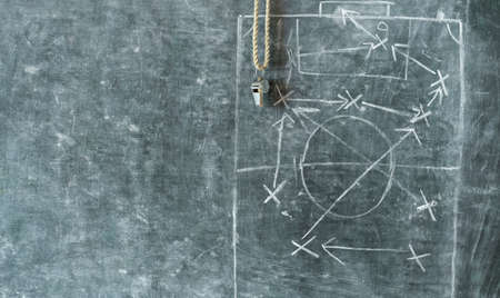 Photo pour whistle of a soccer or football referee on black board with tactical diagram, free copy space - image libre de droit