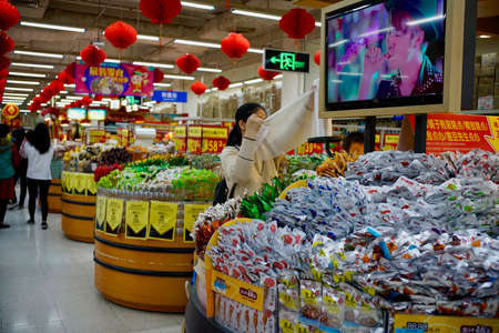 Shenzhen, Guangdong Province, China - 28 December 2019: Different snacks were selling in Walmart in shopping mall.