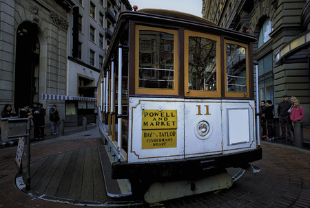 San Francisco: a driver turns a cable car on January 1, 2017. The Powell-Hyde line runs from a terminal at Powell and Market Streets. The city has the the world's last manually operated cable car system
