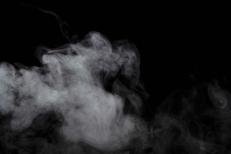 Foto de Abstract powder or smoke effect isolated on black background,Out of focus - Imagen libre de derechos