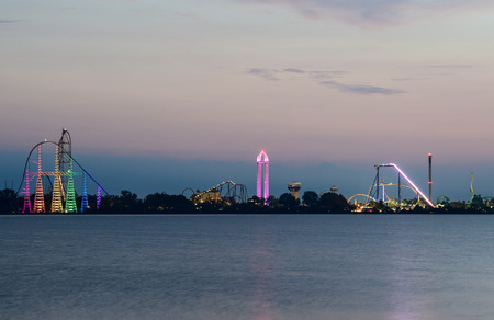 Photo for Ceder point amusement park just before sunrise from the shores of Sandusky - Royalty Free Image