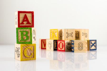 ABC wooden blocks on white background.