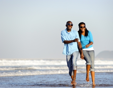 Photo for Attractive couple having fun together at the beach - Royalty Free Image