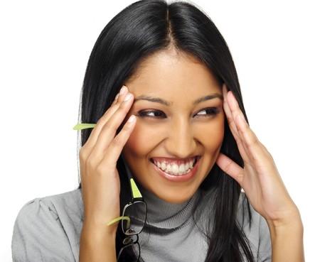 Foto de Cute Indian girl laughs and touches her face - Imagen libre de derechos
