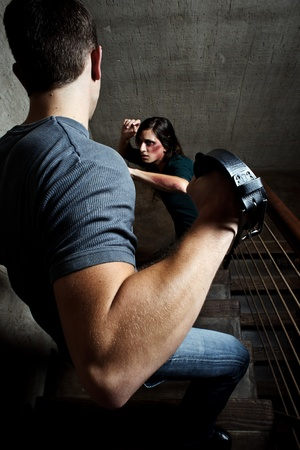 Conceptual shoot of a woman being abused by her partner
