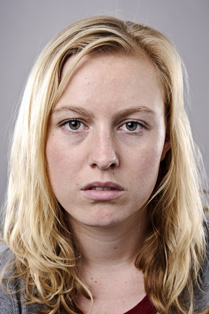 Young blonde woman poses for fine art portrait
