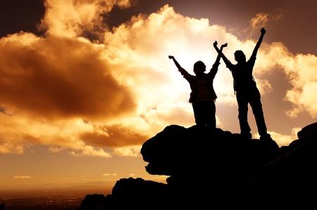 sunset mountain climbing victory celebration