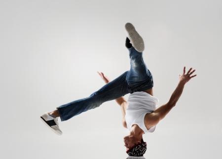 breakdancer frozen in mid head spin, classic modern hip hop or break dance move