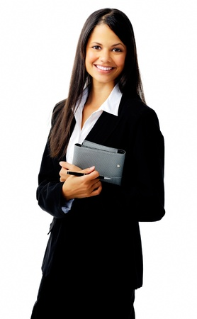 businesswoman standing with organizer diary and smiling