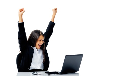 woman with laptop arms raised in victorious celebration of success, isolated on white