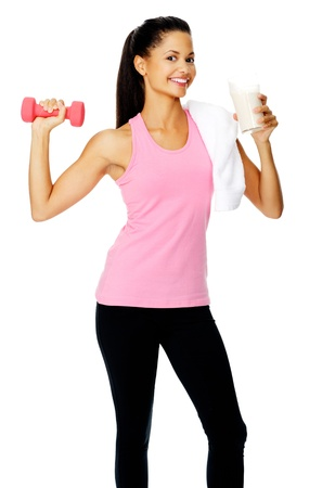 portrait of a beautiful hispanic girl with dumbbell and protien shake